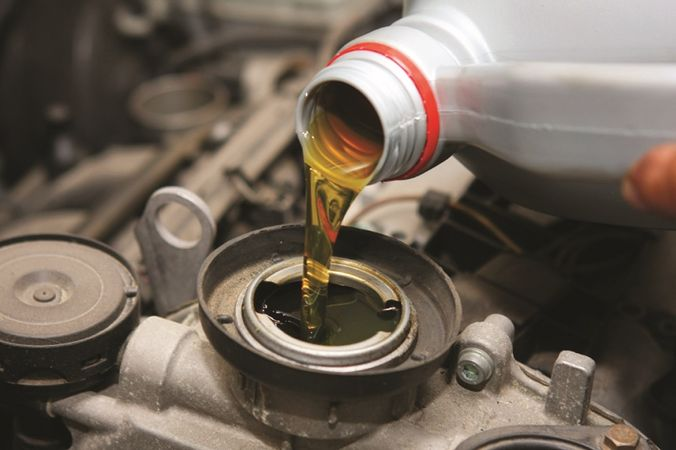 Pour oil into Suzuki Engine